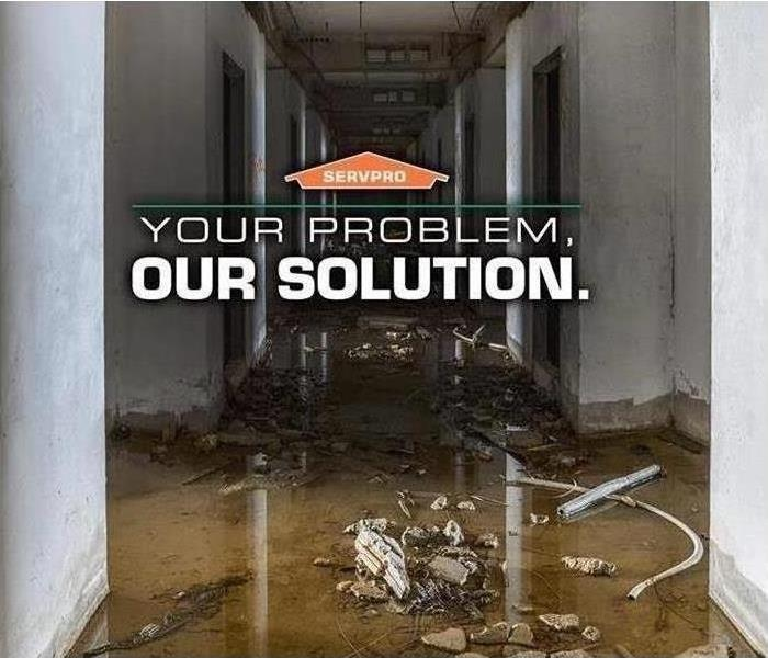 "Flooded Hallway with caption ""Your Problem, Our Solution."""