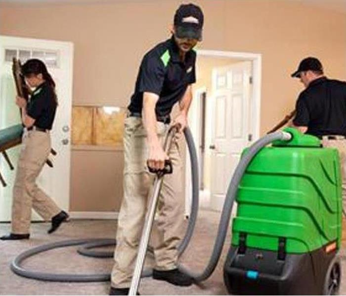 SERVPRO Crew cleaning carpet in a house